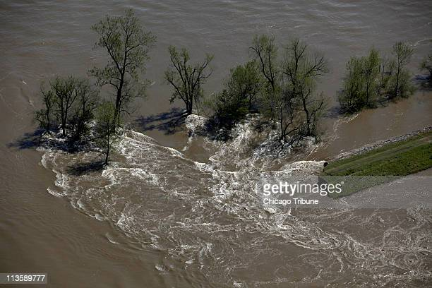 Water swirls around a broken levee in the spillway of Missouri farmland after the US Army Corps of Engineers breeched the levee at Birds Point New...