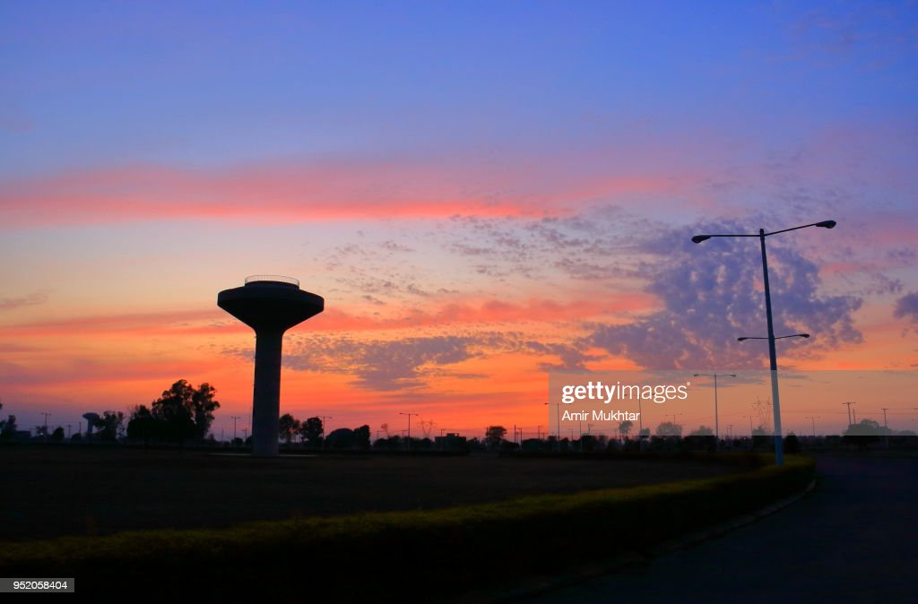 Water Tank and Sunset : Stock Photo