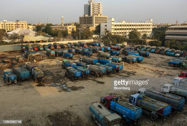 Water tankers sit parked in Karachi Pakistan on Monday Dec 24 2018 Women and children walk miles each day in search forwaterin a crowded...