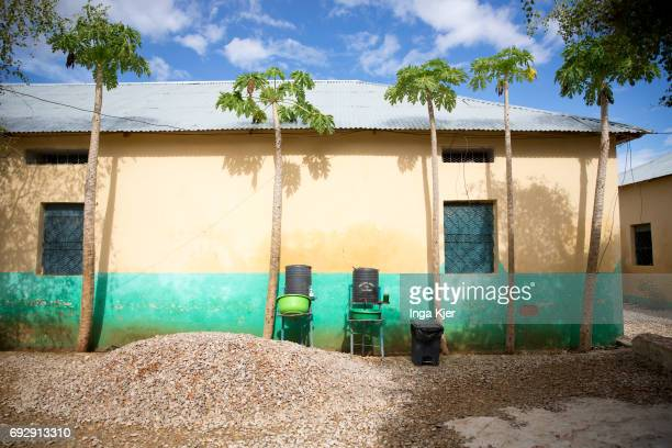 Water tanks stand in front of a building in the rehabilitation center for former fighters of the AlShabaab militia on May 01 2017 in Baidoa Somalia
