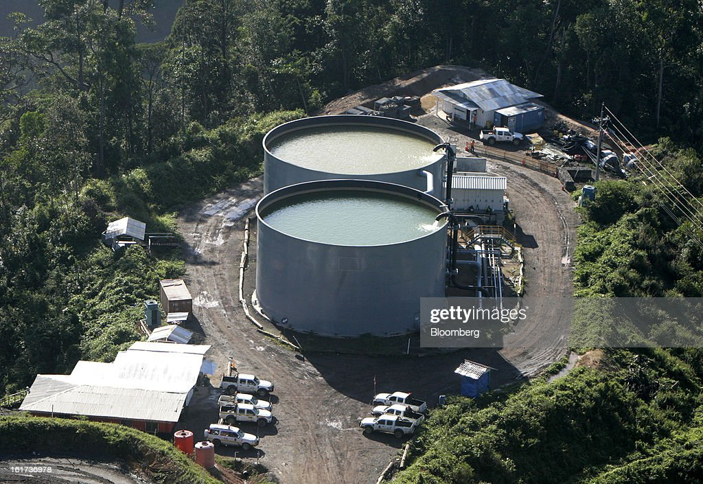 Water tanks stand in this aerial view of the G-Resources Group Ltd. Martabe gold and silver mine in Batang Toru, North Sumatra province, Indonesia, on Wednesday, Feb. 13, 2013. G-Resources is scheduled to announce financial results on Feb. 28. Photographer: Dadang Tri/Bloomberg via Getty Images
