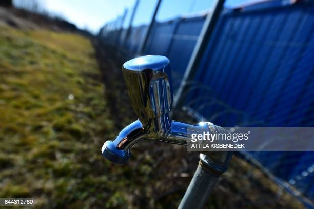 A water tap for migrants is seen in front of the border fence at the HungarianCroatian border nearby Beremend border cross point on February 23 2017...