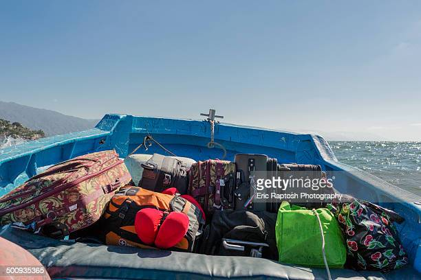 Water taxi at sea loaded with tourists' luggage