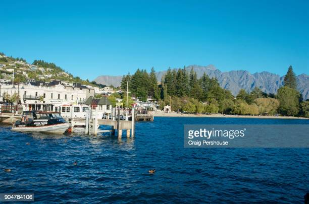 Water taxi at wharf in Queenstown Bay.