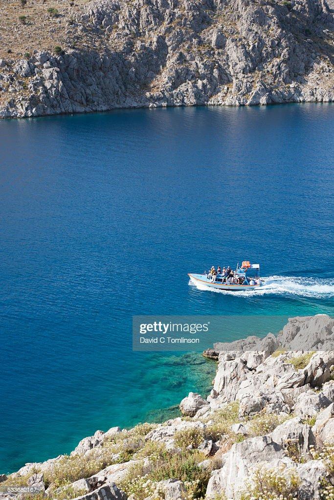 Water taxi crossing Pedi Bay, Pedi, Symi, Greece : Foto stock