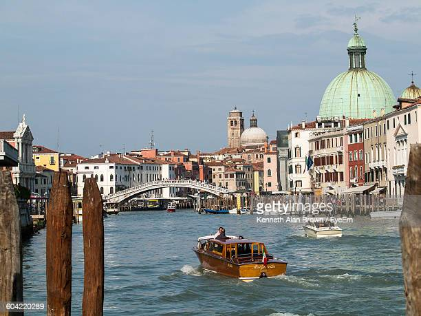 water taxi in grand canal by san simeone piccolo against sky - simeone stock pictures, royalty-free photos & images
