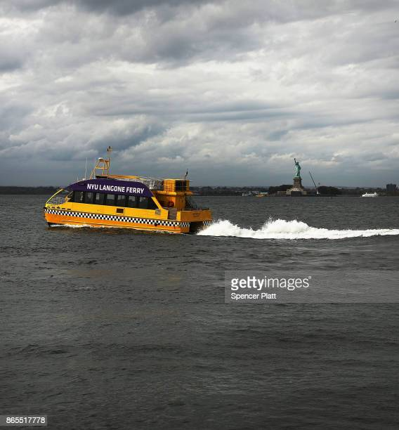 A water taxi leaves Red Hook Brooklyn on October 23 2017 in New York City Red Hook like many coastal neighborhoods in New York was severely flooded...