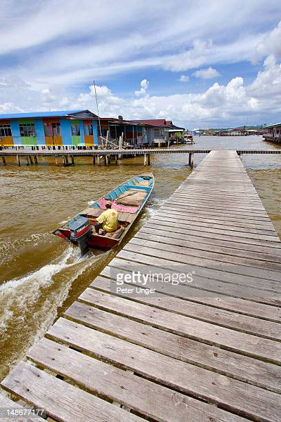 water taxi passing by looking for passengers to pick up at kampong ayer water village. - bandar seri begawan stock pictures, royalty-free photos & images