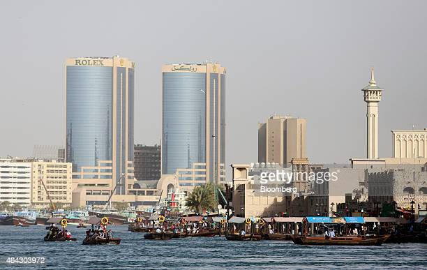Water taxis also known as Abras carry Emiratis and tourists on the waterway in Al Ghubaiba's creek district of Dubai United Arab Emirates on Saturday...