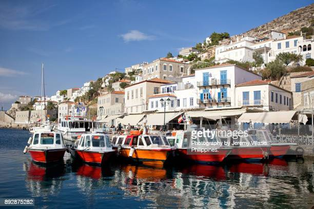 water taxis, hydra island in greece - hydra greece stock photos and pictures