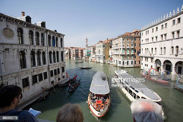 water taxis on canal, venice, italy - schiffstaxi stock-fotos und bilder
