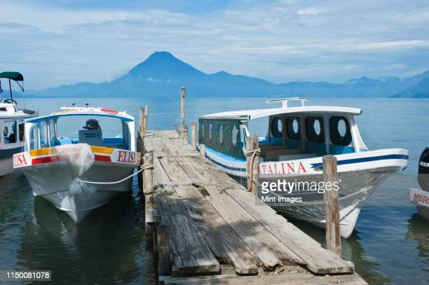 water taxis on lake atitlan - schiffstaxi stock-fotos und bilder