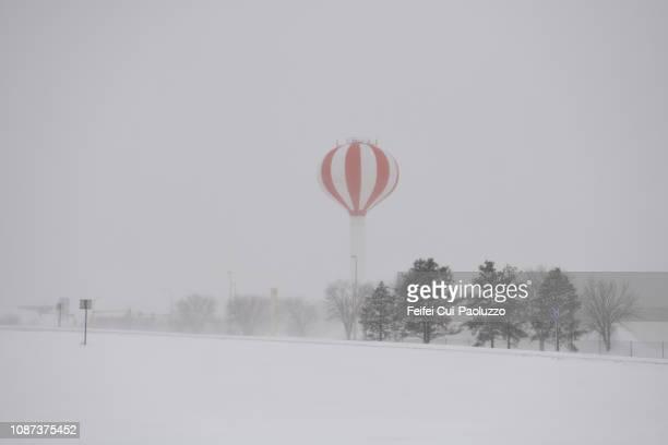 water tower and snow storm at fargo, north dakota, usa - fargo north dakota stock pictures, royalty-free photos & images