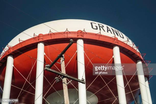 water tower, clear sky, low angle view - grand prairie texas stock photos and pictures