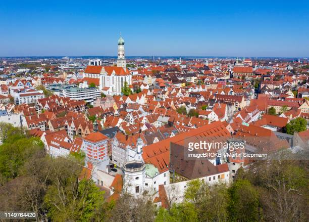 water towers at the red gate and basilica st. ulrich and afra, downtown, augsburg, drone shot, swabia, bavaria, germany - augsburg zwaben stockfoto's en -beelden