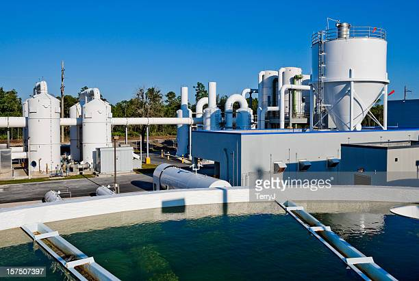 water treatment facility with water tank in foreground - sewer stock pictures, royalty-free photos & images