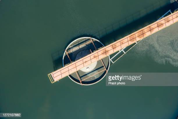"""water treatment solution, industrial water treatment""""u200e, aerial top view recirculation solid contact clarifier sedimentation tank, ecosystem and healthy environment concepts and background. - sports round stock pictures, royalty-free photos & images"""