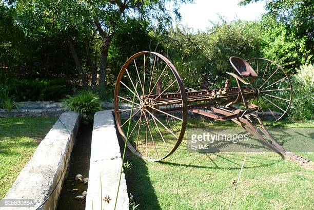 water trench and an old agricultural instrument (harrow) in the hulah valleh - tiller stock photos and pictures