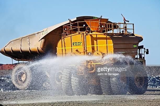 Water truck spraying a road, Kalgoorlie gold mine