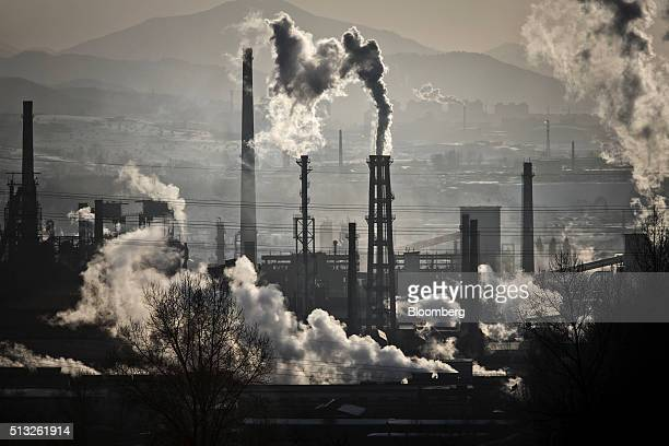 Water vapor and smoke rise from a Tonghua Iron Steel Group Co plant in the Erdaojiang district in Tonghua Jilin province China on Wednesday Jan 6...