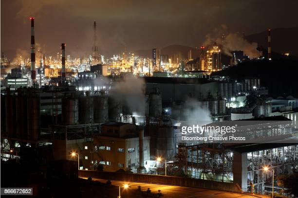 Water vapor and smoke rises from a plant at night in Yeosu