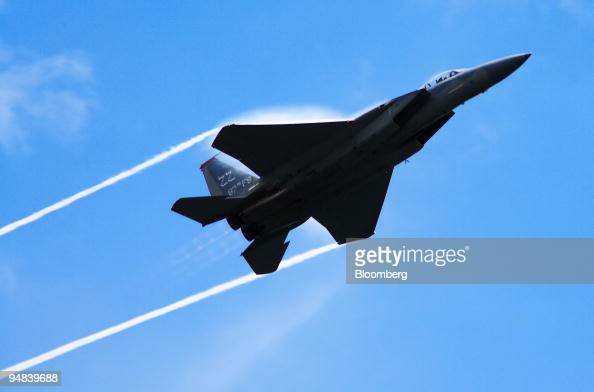 water vapor condenses on the wings of a u s  air force f-15 from the    news photo