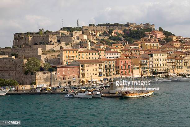 Water view of colorful buildings and harbor of Portoferraio Province of Livorno on the island of Elba in the Tuscan Archipelago of Italy Europe where...