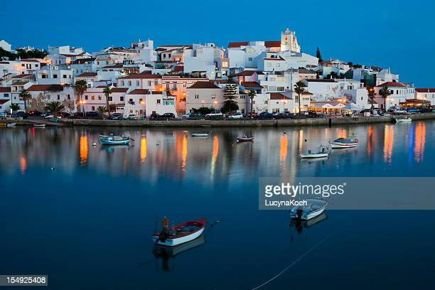 Water view of illuminated cityscape of Ferragudo in Algarve
