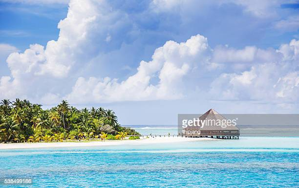 Water Villas (Bungalows) on the Perfect Tropical Island, Beautiful white sand on Tropical beach blue water and blue sky, Maldives islands