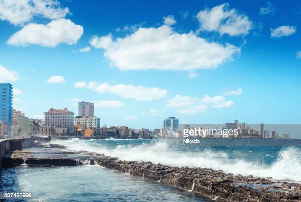water waves crashing against the rocks alongside the Malecon, Havana, Cuba