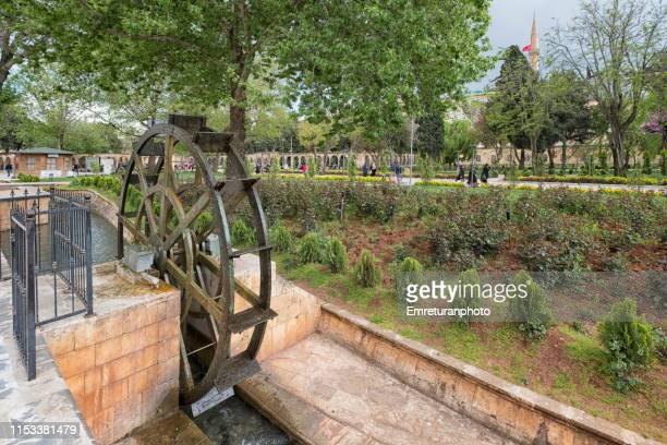 water wheel in canal in public park,şanlıurfa. - emreturanphoto stock pictures, royalty-free photos & images