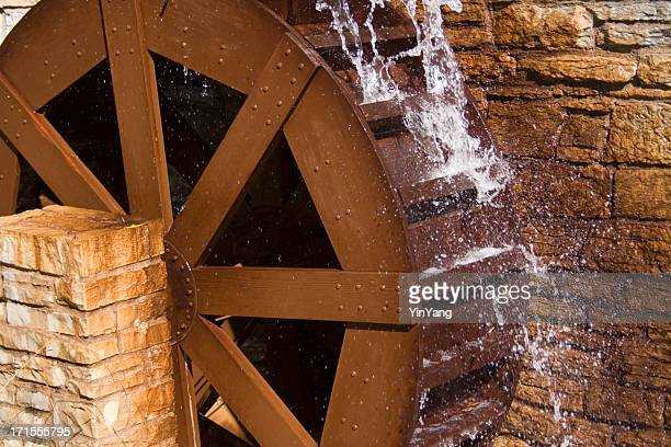 water wheel or watermill turbine grinding, turning, and generating power - mill stock pictures, royalty-free photos & images