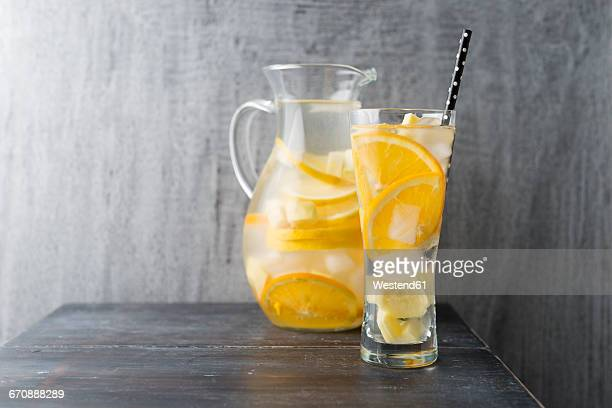 Water with lemon, orange and ginger, ice cubes, flavoured
