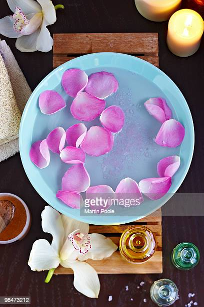 water with rose petals and essential oils