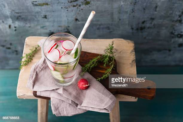Water with thyme, cucumber and red radish, ice-cooled