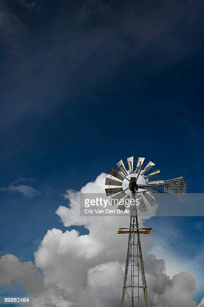 water_windmill_against_sky - eric van den brulle stock pictures, royalty-free photos & images