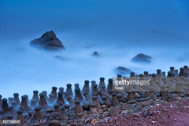 waterbreak in pak nam, chumphon, thailand.  long exposure shot. - barricade stock photos and pictures