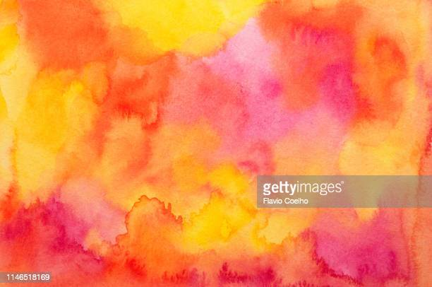 watercolor background in yellow, red, orange and pink tones - wasserfarbe stock-fotos und bilder