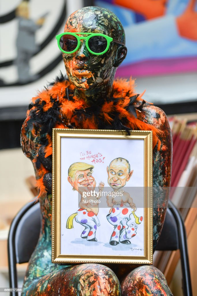 A watercolor caricature which features President Donald Trump and President Vladimir Putin, made by an Irish Artist Ray Sherlock, and placed near Shady Lady art work by Irish artist Frank O'Dea. On Wednesday, 25 October 2017, in Dublin, Ireland.