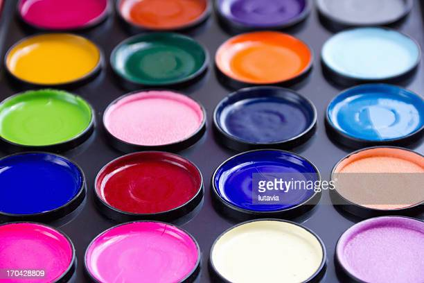 watercolor paint in containers