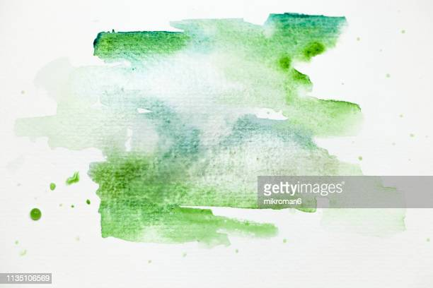 watercolor paint on paper mixed to create a watercolor effect. - watercolor background stock pictures, royalty-free photos & images