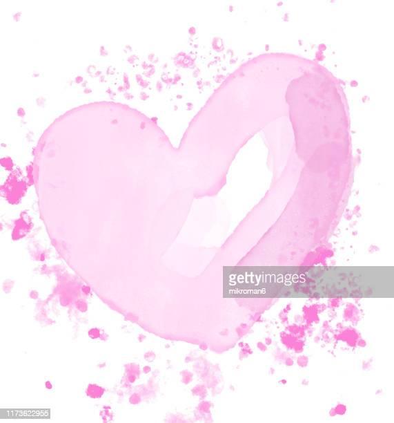 watercolor paint on paper mixed to create a watercolor effect illustration - heart background imagens e fotografias de stock