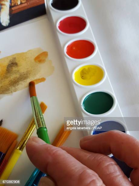 Watercolor painting with paintbrush
