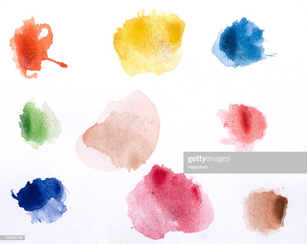 Watercolor paints on a white piece of paper ready to use : Stock Photo
