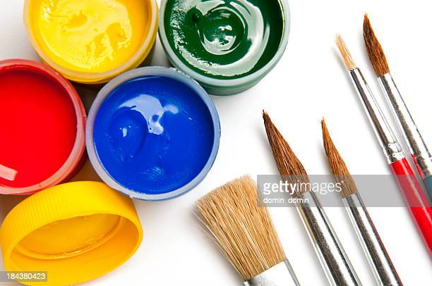 Watercolor paints, poster paints in mini cans, paintbrushes, isolated