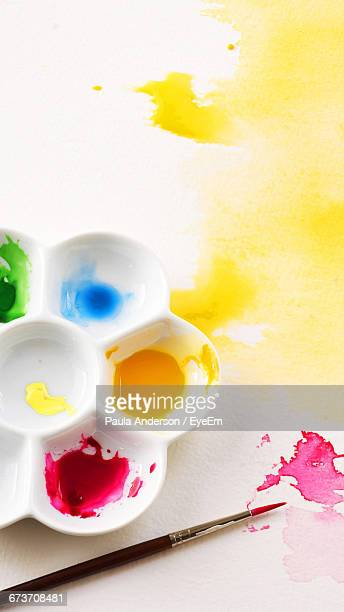 watercolor palette with paintbrush - artist's palette stock photos and pictures