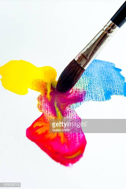 Watercolour mixing with red, blue and yellow