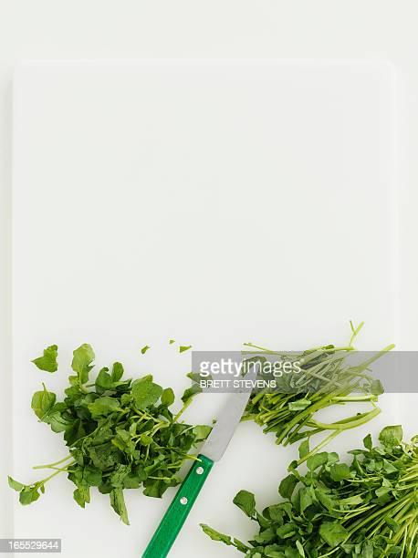 Watercress on cutting board