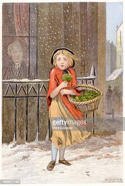 Watercress seller c1880 A young girl in rags and wearing a shawl selling watercress on a street corner in a snowstorm shivering against the cold A...
