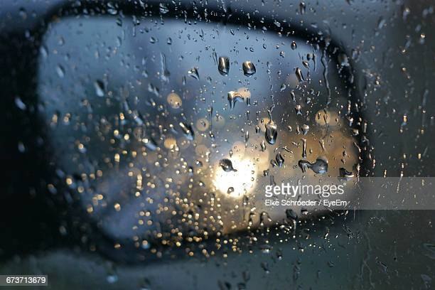 Waterdrops On Glass Against Rear View Mirror